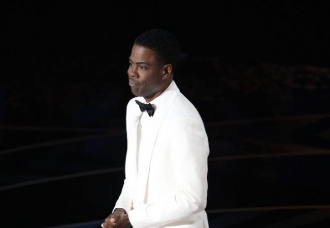 Chris Rock in a white suit
