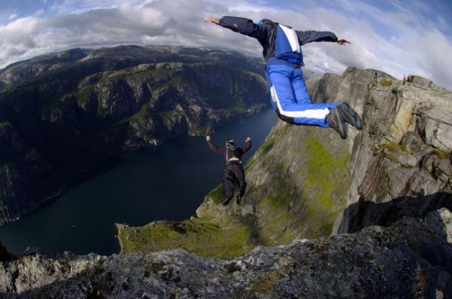 Person skydiving off cliff