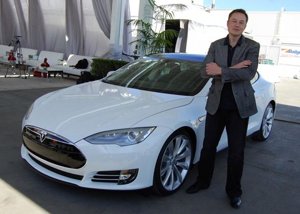Elon Musk with a Tesla car